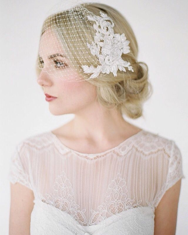 Birdcage veils are short veils that are typically made out of netting. They only cover a portion of a bride's face and fall above the chin. These veils are perfect for brides with a vintage vibe.
