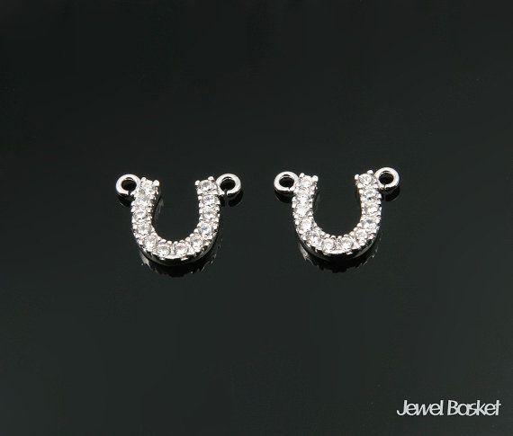 Cubic Zirconia Horseshoe in Rhodium   - High Polished Rhodium Plated over Brass (Tarnish Resistant) - Brass / 8.7mm x 10.5mm  - 12 of Cubic Zirconia - 2pcs / 1pack #cubic #cubicpendant #silvercubic #silver #horseshoecubic #cubicnecklace #horseshoe #horseshoependant #silverhorseshoe