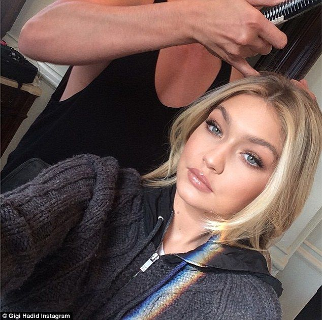 Green-eyed goddess: Gigi Hadid shared a luminous selfie as her hairstylist prepped her lon...