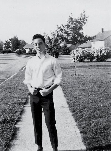 Billy Joel outside his home in Hicksville, N.Y., in 1964, the year he started playing in a rock n roll band.