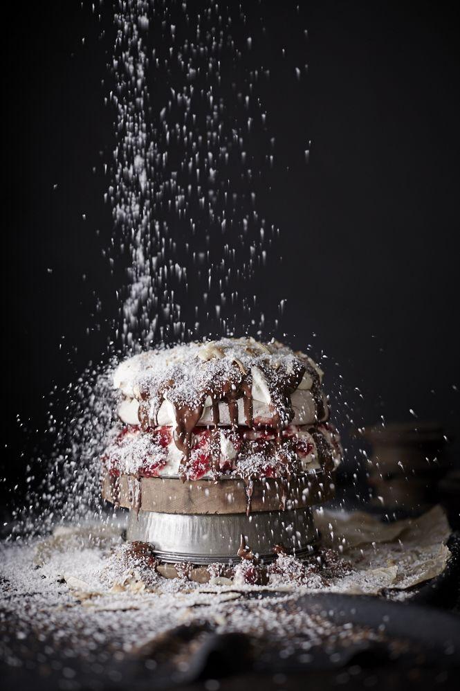 lamalova (pavlova + lamington) chocOlate pavlova with whipped cream, lingonberry jam, melted dark chocolate & toasted coconut flakes
