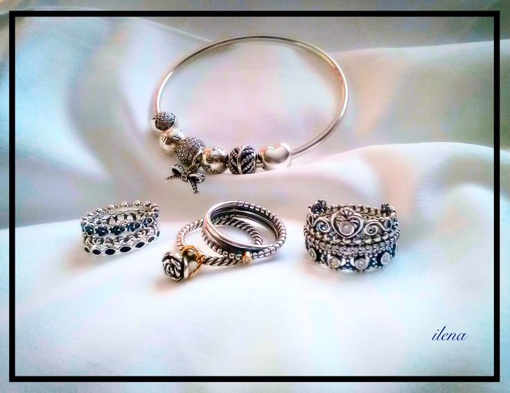 Pandora rings and bangle with silver charms. Ilena