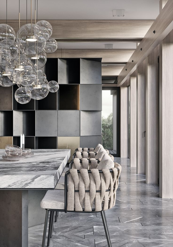 Contemporary Kitchen // Statement counter lighting, woven chairs, modern millwork.