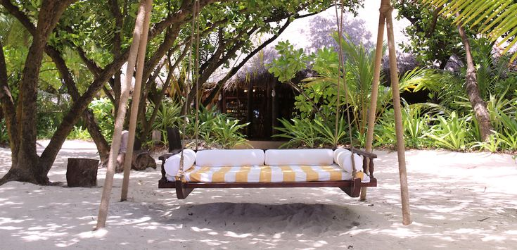 Relaxing hours on the traditional Swing at Coco Palm Dhuni Kolhu on the Maldives.