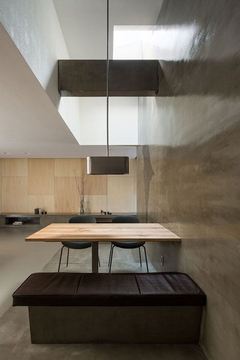 Japanese house featuring shifting ceiling heights to create a variety of spaces inside