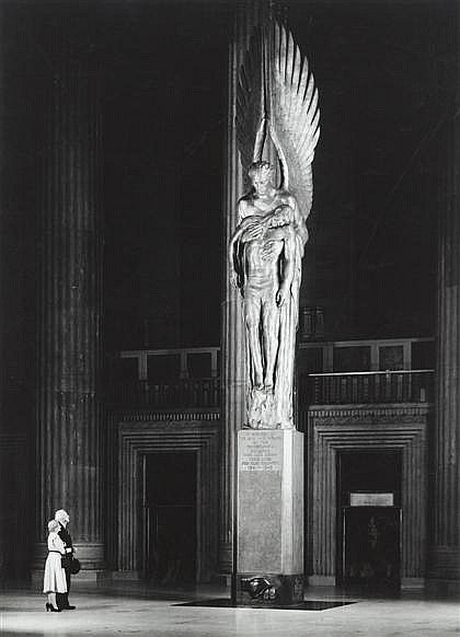 """Pennsylvania Railroads 30th Street Station in Philadelphia, a War Memorial named """" The Angel of The Resurrection."""" Standing at 38 feet, the Statue is a depiction of the Arc Angel Michael, which is bearing the body of a fallen Soldier. This superb Bronze Statue was designed by Walter Hancock. The statue was placed on permanent display inside the massive main hall of the Train station in 1952. The Statue was dedicated to the 1,307 Employees of the Pennsylvania Railroad, who lost their lives in…"""