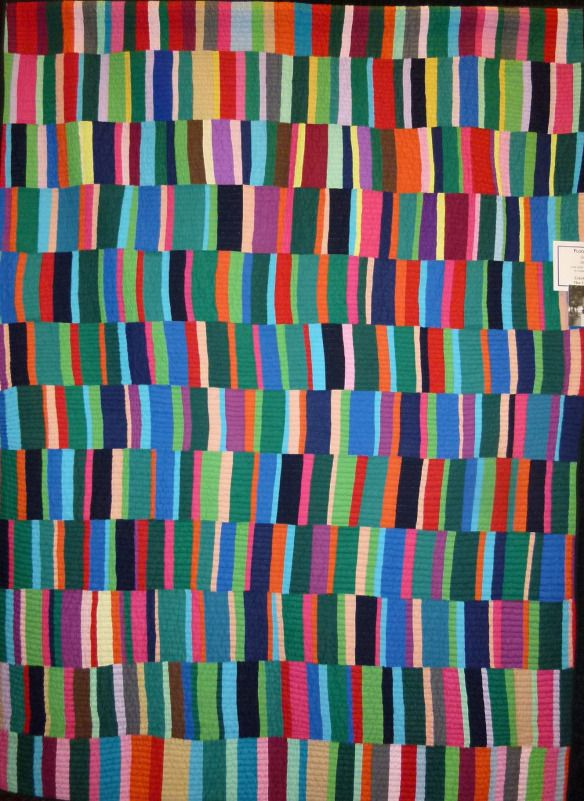Philippine quilt. The colours are mostly compatible with Amish quilts, but the proportion of darks to brights is much smaller. The top few rows also are somewhat different in colour combination.
