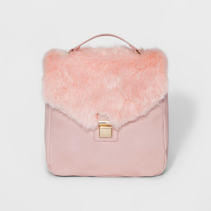 Add a fun and sophisticated accessory to your look with this Faux Fur Square Backpack from T-Shirt & Jeans. Adjustable shoulder straps make sure you get the perfect fit to carry your belongings in comfort. The furry top flap adds a pop to any outfit, dressing up a casual look or adding some fun to a dressier style. A metal clasp keeps your belongings secure, and interior pockets make sure your essentials are easy to find.