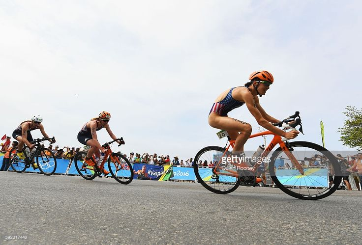 Gwen Jorgensen (20) of the United States, Non Stanford (16) of Great Britain and…