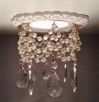 5″ Decorative Recessed Light Trim with Crystals replaces industrial plastic trim. Easy to install. The decorative trim comes in 14 finishes. Lots of crystal options and styles to create a custom and attractive decorative recessed light trim with crystals.