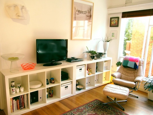 IKEA Expedit Shelves as Entertainment Center. Love the use of space.