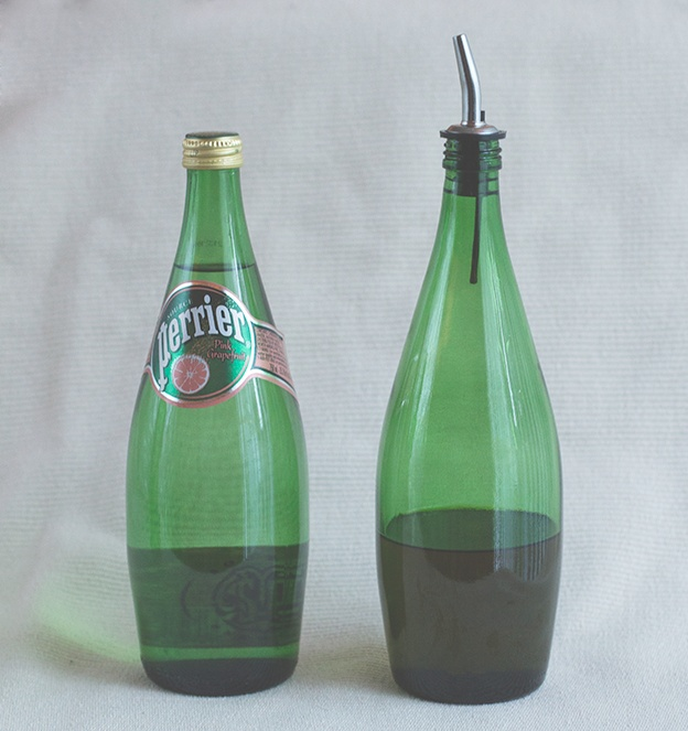Recycle an old Perrier bottle into an olive oil cruet.  This is a great frugal way to create your own infused oils, like rosemary, garlic, or lemon.