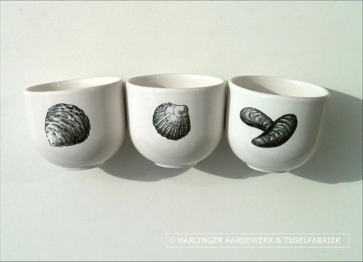 hand painted black and white decoration on these cups