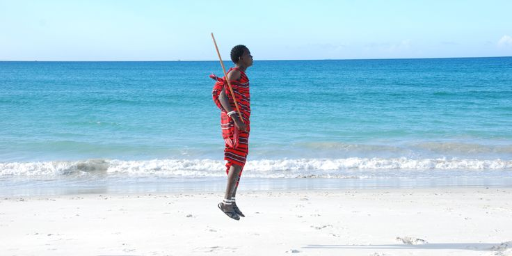 Maasai dance along the shores of Kigamboni in Dar Es Salaam, Tanzania