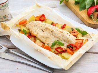 Хек запеченный с овощами в духовке