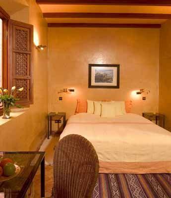 Moroccan bedroom design yellow orange wall paint ideas for Orange paint ideas for bedroom