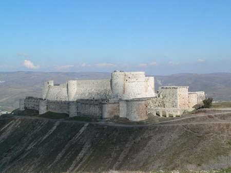 Krak des Chevaliers in Syria (loosely translated as The Fortress of Knights).  And, this castle is considered to be one of the most important medieval military castles in the world. It played a tremendous part in the crusades and the original fortress was built in 1031.  It played a role in the First Crusade, was captured, and a century later it was the headquarters of the Knights Hospitaller.  Saladin attempted (unsuccessfully) to capture it in 1188 by laying siege to it.