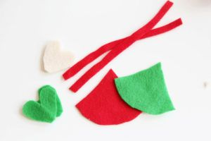 Make these adorable pinecone elves to hang on the tree or tie on a garland. Kids will love helping with this easy Christmas craft!