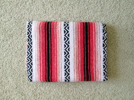 This blanket has multiple uses, it can be used as a throw (it is soft and warm), as home decor, a yoga mat, a blanket, bed covering, or as a rug. Would also make a great blanket to keep in the car or to use on the beach or for a picnic. Light to medium-weight blanket. Nice mix of pink/red/orange/salmon tones with white and black threads as well. The blanket is in good condition with some light signs of use, such as fuzzies present from washing and creases from folding. There a...
