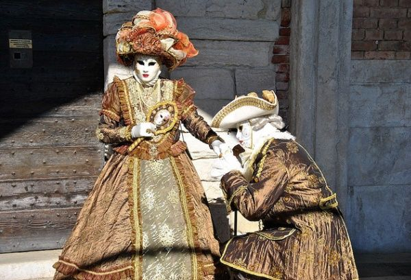 Both men and women don carnival costumes and masks in Venice