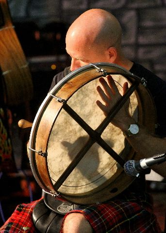 """Bodhran Irish drum is MIS-SPELLED on many Pinterest pins. cSw MOST POPULAR RE-PINS via DdO:). RESEARCH  - http://www.pinterest.com/claxtonw/ - Bodhran is pronounced """"BOW-ron"""" - """"dh"""" is silent. GREAT lighting in photo shows musician's hand thru translucent drumhead.  Hand-held drum is played to accompany jigs, reels, etc. Its frame = 25 to 65 cm (10"""" to 26"""") diameter; most drums are  35 to 45 cm (14"""" to 18"""").  As with most Gaelic spellings, the word """"bodhran"""" keeps you guessing for…"""
