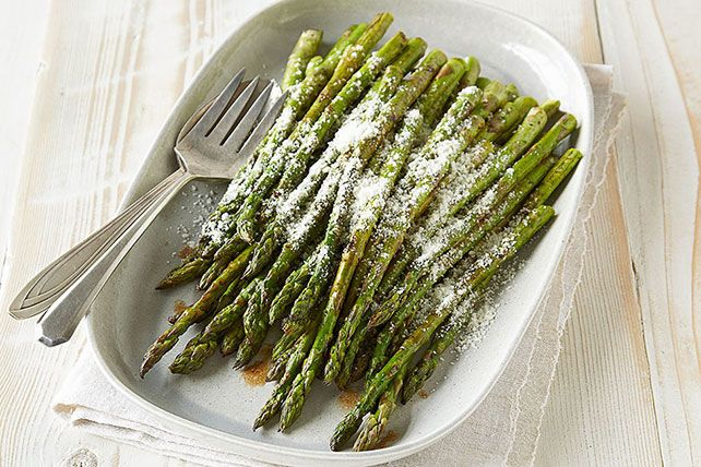 Fresh asparagus spears are dressed in balsamic vinaigrette and grated Parmesan and grilled till crisp-tender in this simple yet elegant side.