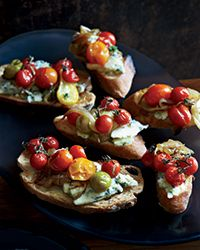 These incredible crostini are topped with super-juicy roasted cherry tomatoes and salty Stilton cheese.  - My friend made these recently - they're amazing!