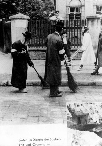 "Warsaw, Poland, Jewish forced labor. Written on the photograph is an explanation in German: ""Jews in the service of cleanness and order""."