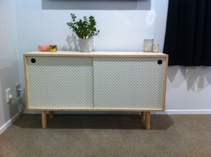 Peg board cabinet completed.  Half a sheet of ply, glue, peg board, and dowel for the legs. $138 to make.