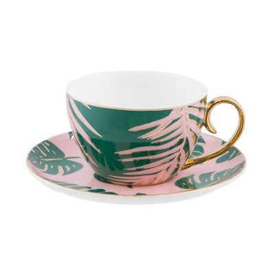 Experience High Tea in style with this luxury Teacup & Saucer by Cristina Re. Escape to a dreamy tropical resort with the new 'Paradise Palms' Collection, inspired by luscious green fauna, magical pink sunsets and deep blue oceans. Made from the finest quality New Bone China and embellished by hand with a lustrous 24ct gold finish. Designed to coordinate with an array of accessories from the Cristina Re High Tea Collection, you will be sure to inspire and delight your guests.