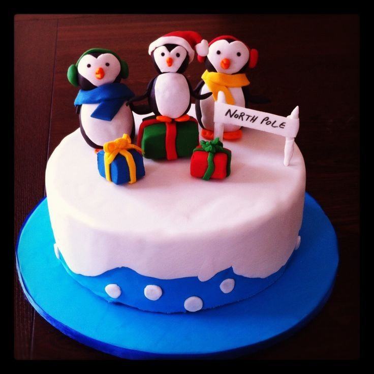 Christmas themed cake decorated with fondant penguins.