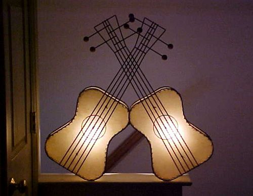 Frederic Weinberg guitar lamps. He made several string instruments in the shape of wall sconces