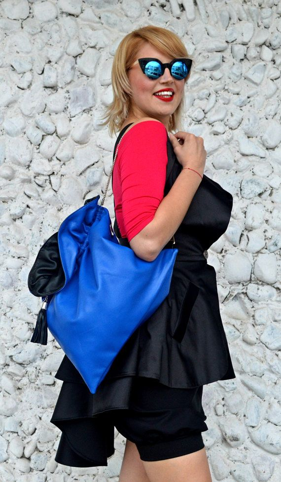 Extravagant blue leather bag, easy to wear, fun and so versatile. Playful genuine leather bag, practical and outstanding. This leather tote will for sure steal the spotlight this season!  Material: 100% genuine leather