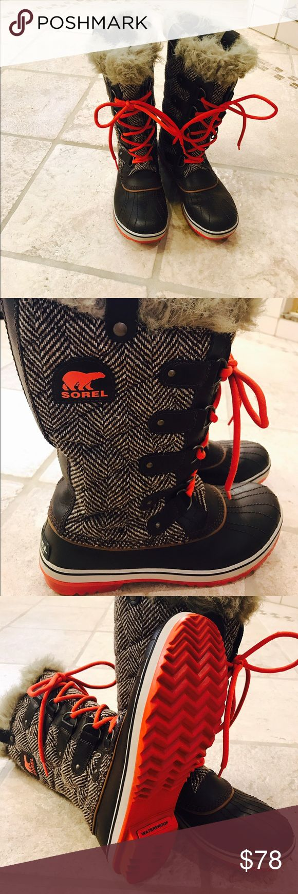 Sorel Snow Boots Brown waterproof snow boots with orange soles and shoe laces.  Topped with faux fur to keep your feet warm while sporting a little style.  Size 11.  This particular boot runs small.  I would size up one size. Sorel Shoes Winter & Rain Boots
