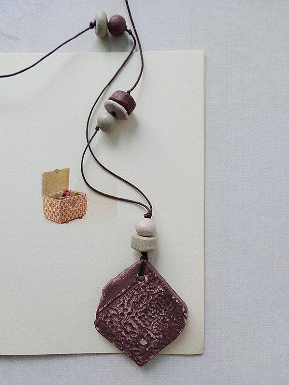 Asymmetrical burgundy ceramic unique handmade pendant