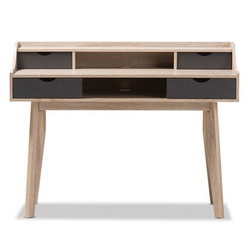 Complete your minimalistic-styled space with the Writing Desk from Baxton Studio. The neutral color and clean-cut edges lend themselves to a contemporary look, while the black drawers add a defining touch. Two rows of drawers provide ample space for storage and decor, while the cable grommet makes it easy to keep your laptop, tablet, monitor and the like charged and organized. Style the tabletop surface with a row of fresh succulents and a stack of your favorite books, or store your writing…