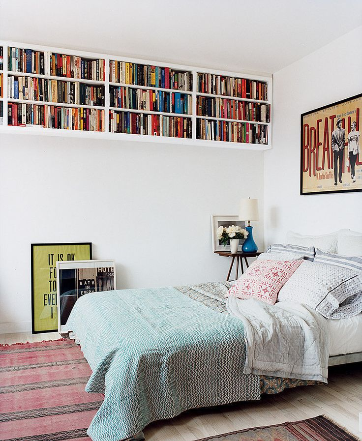 Not only does a raised bookcase create a place for books, it frees up ground space for things like an alternative gallery wall.