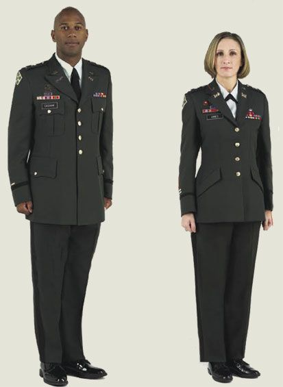 Male and female officers standing at attention wearing green officer uniform