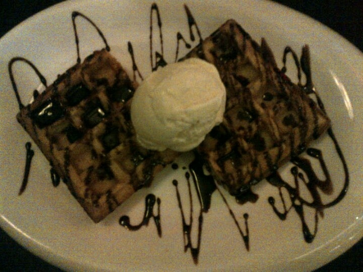 Waffle with chocolatte sauce and vanilla ice cream topping at Daily Bread Cafe