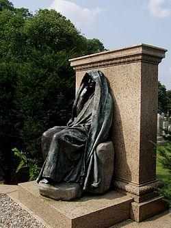 Adams Memorial is a grave marker located in Section E of Rock Creek Cemetery, Washington, D.C., featuring a cast bronze allegorical sculpture by Augustus Saint-Gaudens. The shrouded figure is seated against a granite block which forms one side of a hexagonal plot, designed by architect Stanford White.