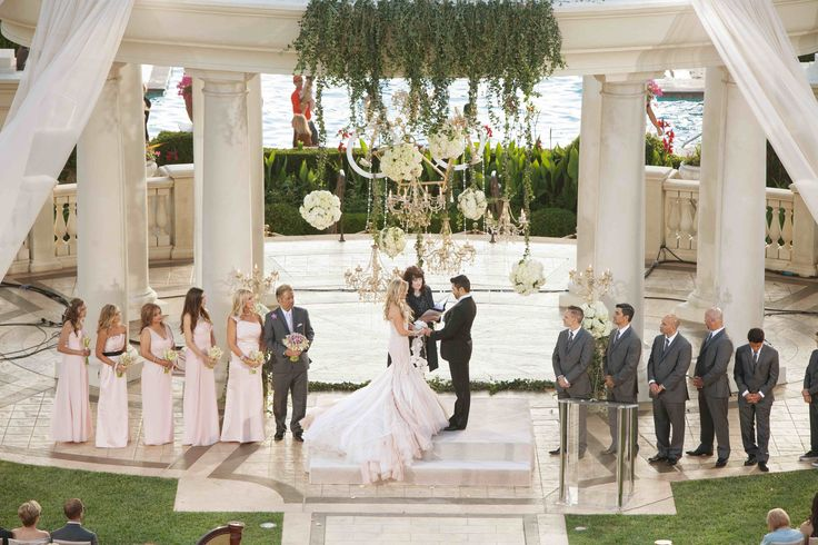 Reality star Tamra Barney and her groom were married on an oceanfront lawn of a luxury Southern California resort. They exchanged vows beneath a towering gazebo embellished with greenery, white drapery, and ivory blooms. #weddingceremony #decor Photography: Christine Bentley Photography. Read More: http://www.insideweddings.com/weddings/tamra-barney-and-edward-judge/471/