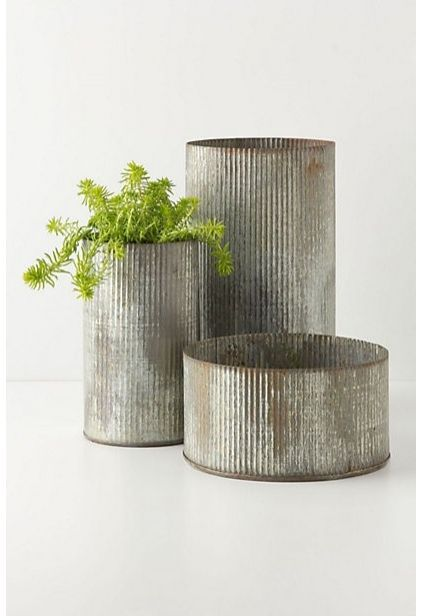 Just buy a large sheet of corrugated metal at home depot and keep on hand to cut and wrap around glass containers for great centerpieces.