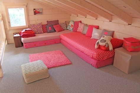 Good idea: put some mattresses one on each other, add some pillows and there!, you have a nice sofa!