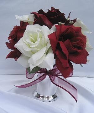 floral centerpieces in silver vases | These gorgeous bouquets consist of : Burgundy and ivory open roses ...