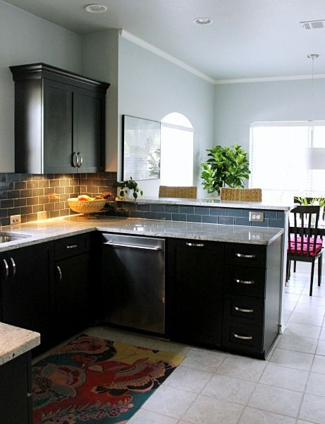 Kitchen With Espresso Shaker Cabinets Glass Tile Backsplash And Farrow Ball Skylight