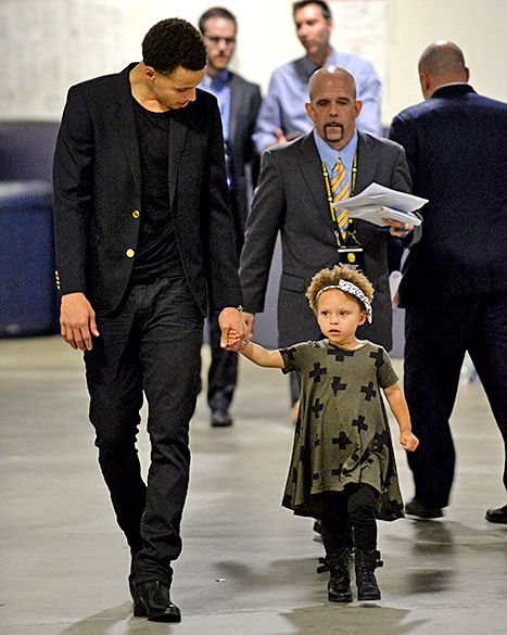 Stephen Curry #30 of the Golden State Warriors and his daughter Riley walk toward to the post game press conference on May 19, 2015.