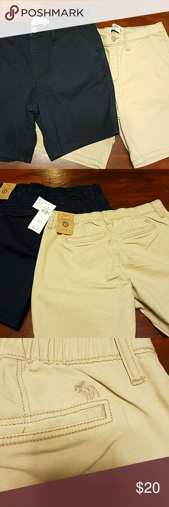Abercrombie girls SZ 13/14 NWT boyshorts bundle 2 pairs of girls Abercrombie kids size 13/14 boyshort short. Elastic around waist, pockets in front and back. Khaki-colored and navy colored new with tags. Smoke and pet free home. These have a retail of 29.95 each. Abercombie Kids Bottoms Shorts