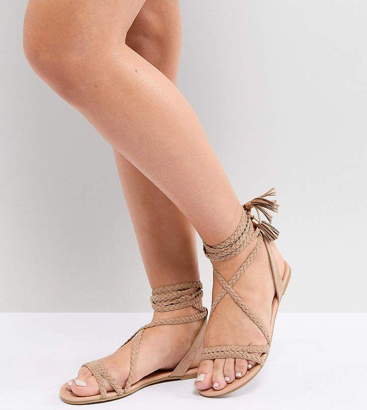 de98a7ba512 Asos DESIGN Fayla Wide Fit Tie Leg Plaited Flat Sandals