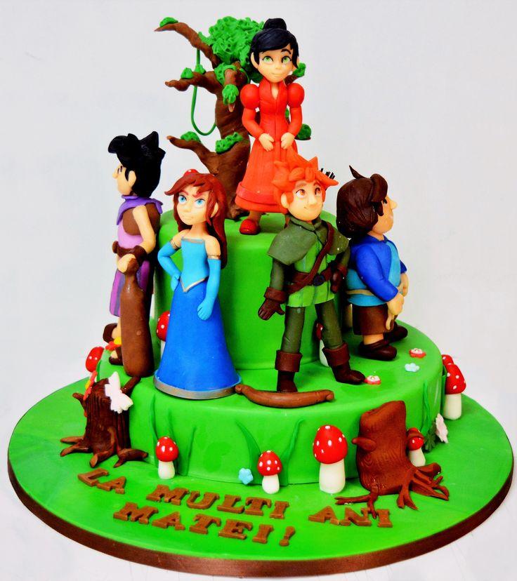 Filmul animat Robin Hood si padurea Sherwood a fost alegerea lui Matei pentru figurinele ce i-au decorat tortul aniversar si care a fost un adevarat succes la petrecere unde toti copiii si-au dorit o portie din deliciosul tort.  Tortul se poate realiza doar pe doua etaje. Pentru o cantitate mai mica, te rugam sa ne scrii un email, iar echipa cofetariei Armand o sa gaseasca varianta potrivita pentru tine.