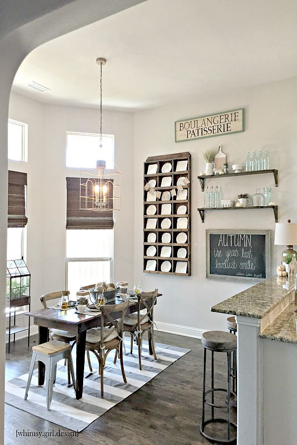 A few key pieces, like the Boulangerie sign, rustic chalkboard, wicker lamp and glass bottles from HomeGoods, give our breakfast nook a cozy, farmhouse feel! {Sponsored Pin}